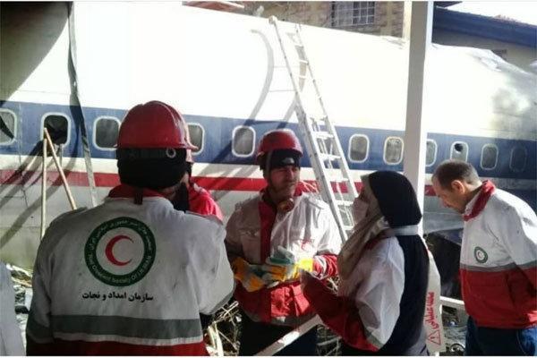 امدادرسانی نیروهای امدادی هلال احمر تهران در حادثه سقوط هواپیما